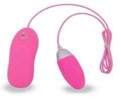 Розовое виброяйцо на пульте управления
