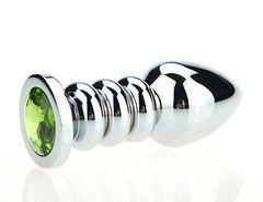 Серебристая фигурная анальная пробка с зелёным кристаллом - 10,3 см.